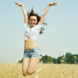 Jumping girl at field — Stock Photo #5436243