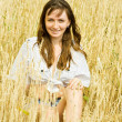 Girl at cereals field — Stock Photo #5436247