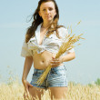Girl with wheat ears — Stock Photo #5436267