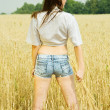 Girl at cereals field — Stock Photo #5436282
