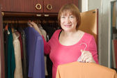 Mature woman looking at clothes — Stock Photo