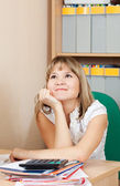 Woman is dreaming on her workplace — Stock Photo