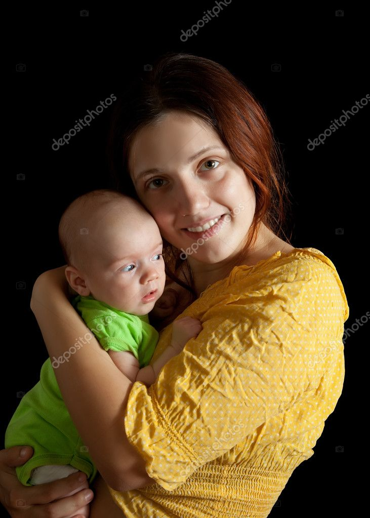Woman with 1 month baby, Isolated over black background — Stock Photo #5430556