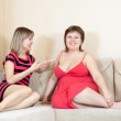Women talking on sofa — Stock Photo