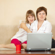 Wonder women looking to laptop — Stock Photo #5711821