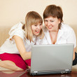 Happy women with laptop — Stock Photo