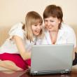 Happy women with laptop — Stock Photo #5711828