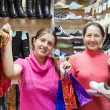 Happy women at shoe store — Stock Photo #5712250