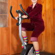Woman exercising on exercise bike — Stock Photo #5712420