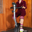 Woman exercise on spinning bicycle — Stock Photo