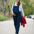 Royalty-Free Stock Photo: Months pregnant woman walking on street