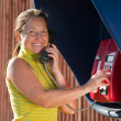 Woman  on  pay phone — Stock Photo