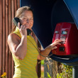 Woman  on the payphone — Stock Photo