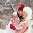 Girls plays  at winter park — Stock Photo