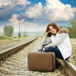 Girl on railway with suitcase — Stock Photo