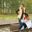Girls sitting on rail — Stock Photo