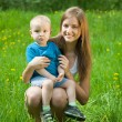 Stock Photo: Teen sister and baby brother