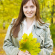 Girl with maple leaves — Stock Photo #5715446