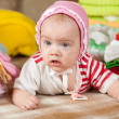 Baby girl with children's clothes — Stock Photo