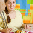 Woman eating breaded fish — Stock Photo #5715941