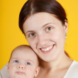 Happy mother with her little daughter — Stock Photo #5716730