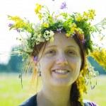 Portrait of girl in flowers chaplet — Stock Photo #5717606