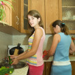 Family in the kitchen — Stock Photo #5717770