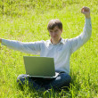 Happy man with laptop — Stock Photo