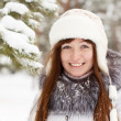Smiling girl in wintry park — Stock Photo #5717819