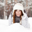Girl lying down on snow — Stock Photo #5717825
