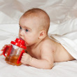 Baby girl with sippy cup — Stock Photo #5717834
