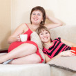Women having fun with cups of tea — Stock Photo #5718040