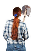 Rear view of woman with spade — Stock Photo