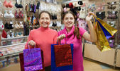 Women with shopping bags in underwear shop — Zdjęcie stockowe