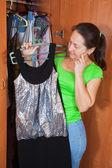 Woman standing at wardrobe — Stock Photo