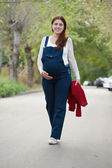 Months pregnant woman walking on street — Stock Photo
