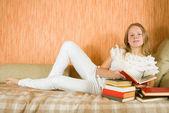 Girl reading books — Stock Photo