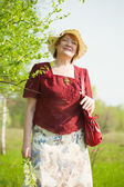 Woman against spring landscape — Stock Photo