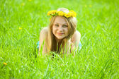 Girl in grass at meadow — Stock Photo