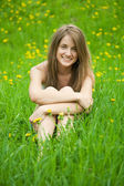 Teenager girl in grass — Stock Photo