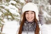 Smiling girl in wintry park — Stock Photo