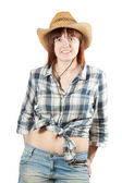 Woman in chequered shirt and straw hat — Stock Photo