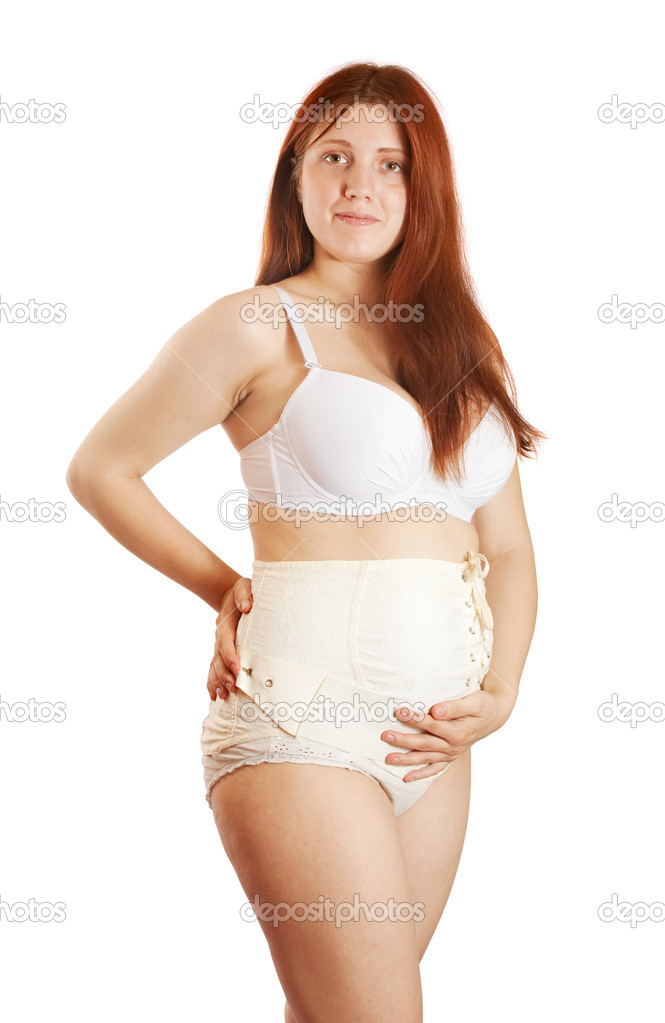 Pregnant woman wearing belly bandage. Isolated over white — Stock Photo #5712380