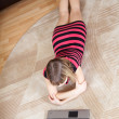 Girl lying on floor and using laptop — Stock Photo