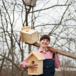 Royalty-Free Stock Photo: Woman with  new birdhouses