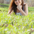 Stock Photo: Woman relaxing in grass