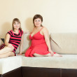 Stock Photo: Women having fun on sofa