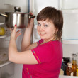 Woman putting pan into refrigerator — Stok fotoğraf