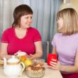 Two girls drinking tea and gossiping — Stock Photo #5722523