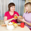 Girls have tea with cookies — Stock Photo #5722547